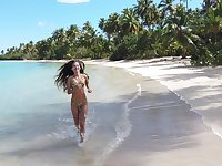Slender Colombian babe in sexy bikini Irene Rouse running on the beach