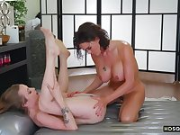 Naughty lesbian friends enjoy massage and squirting sex session