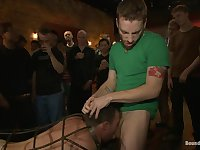 Bound in Public. Stud in a metal cage is fucked by horny bar patrons
