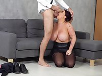 Chubby chick in a leather mini skirt sucks big cock