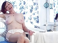 Horny retro redhead British lady Scarlet sexily undresses and masturbates