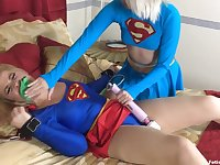Pair of horny supergirls playing with vibrator in bed