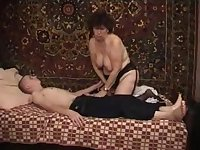 Doing a luscious granny who can't get enough of his young cock