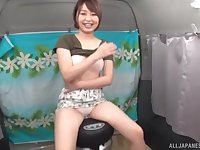 Short haired cute Japanese MILF undresses in a van