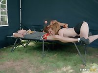 Two Army nurses share his huge cock in a tent