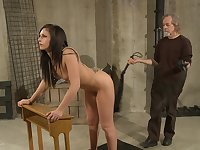 Older guy uses a whip to make his slave's back and ass swell