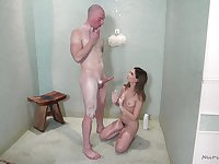 Oiled up brunette Jane Wilde massages a cock with her mouth and hands