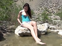 Redhead nature loving teen babe masturbates in a pond