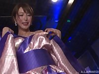 Japanese babe in a costume Kimijima Mio gets on her knees to suck dick