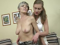 Gabriella D. stuffs the shaved pussy of Irenka S. with a dildo