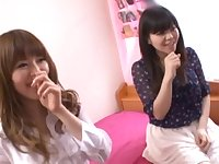 Japanese teen lesbians with natural tits play with a vibrator