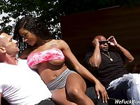 Busty inked ebony babe Sarai Minx in an interacial MMF threesome