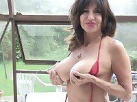 Tara Holiday exposes her huge tits and plays with her pussy