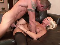 Naughty blonde deals the dick on a leather couch
