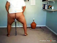 Black girl plays with bat on cam