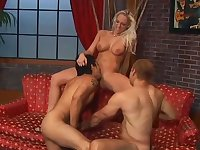 Busty chick joins the boys with a strap-on - Pure Filth Productions