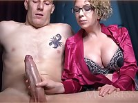 Wild mature girl with blondie hair and glasses is groping manhood in front of the camera