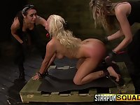 Two mistresses put on strapons and fuck mouth and pussy of Layla Price