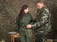 Asian chick in military uniform Aisha San gives a good blowjob to one soldier