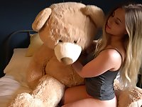 Libidinous beauty Sophie K is playing with her favorite big teddy bear