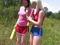 Two stunning girls are eating each others pussies in the field in broad daylight