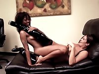 Erotic lesbian tryout on a leather couch for two naked women