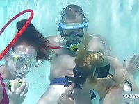 Babes take turns sucking dick underwater and they are so adventurous