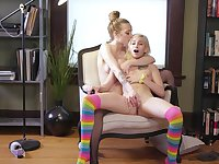 Lesbians share passion on a chair in mutual XXX duo