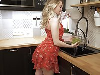 Svelte girl named Sophie climbs onto the kitchen counter to masturbate