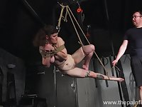 Hogtied slut Ivy is hung above the floor and treated rather hard