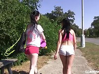 Two beautiful teens enjoy having sex in outdoors with a dildo