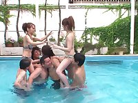 Outdoors lesbian fucking in the pool with some very lucky guys