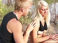 Passionate outdoors fucking between a sexy girl and her boyfriend
