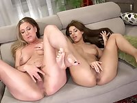 Two dirty cougars are having some lesbian fun on the sofa